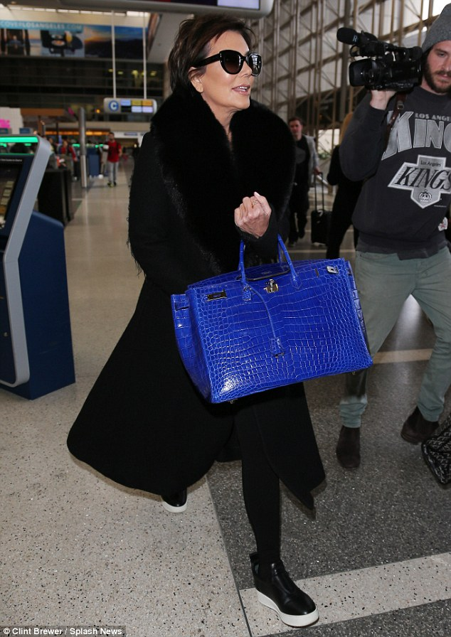 Her favourite accessory! The Keeping Up With the Kardashians star was spotted three times within a week carrying the electric blue designer crocodile handbag
