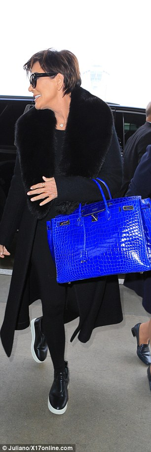 Pop of colour! Jenner's monochrome ensemble made her brightly-coloured purse - which can sell for up to $95,000 online - stand out even more from her wardrobe