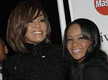 FILE- In this Feb. 12, 2011 file photo, singer Whitney Houston, left, and daughter Bobbi Kristina Brown arrive at the Pre-Grammy Gala & Salute to Industry Icons with Clive Davis honoring David Geffen in Beverly Hills, Calif. A judge in Atlanta has granted a television station's request to unseal the autopsy report for Bobbi Kristina Brown. The 22-year-old daughter of Houston was found face-down and unresponsive in a bathtub in her suburban Atlanta townhome Jan. 31, 2015, and died in hospice care July 26. (AP Photo/Dan Steinberg, File)