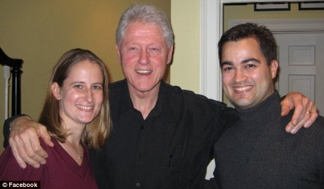 All in the family: Bill Clinton posed for a photo as well with Pagliano and his wife. Pagliano set up the private email server in Hillary's New York home in 2009