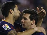 Barcelona's Lionel Messi, right, celebrates with teammates Luis Suarez, centre, and Neymar, left after scoring their side's third goal against Rayo Vallecano during a Spanish La Liga soccer match between Barcelona and Rayo Vallecano at the Vallecas stadium in Madrid, Thursday, March 3, 2016. Messi scored a hat trick in Barcelona's 5-1 victory. (AP Photo/Francisco Seco)