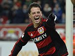 Bayer Leverkusen's Javier Hernandez celebrates his third goal with teammate Karim Bellarabi, right, during the German Bundesliga soccer match between Bayer Leverkusen and Borussia Moenchengladbach in Leverkusen, Germany, Saturday, December 12, 2015.   Leverkusen defeated Moenchengladbach with 5-0, Hernandez scored three goals.    (AP Photo/Martin Meissner)