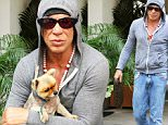 EXCLUSIVE: Mickey Rourke seen sporting a baseball rosary, wearing hoodie, blue jeans and LV man purse\n\nPictured: Mickey Rourke\nRef: SPL1240534  030316   EXCLUSIVE\nPicture by: KAT / Splash News\n\nSplash News and Pictures\nLos Angeles: 310-821-2666\nNew York: 212-619-2666\nLondon: 870-934-2666\nphotodesk@splashnews.com\n