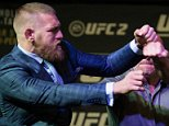 LAS VEGAS, NV - MARCH 3:   (L-R) UFC featherweight champion Conor McGregor throws a punch towards Nate Diaz during the UFC 196 Press Conference at David Copperfield Theater in the MGM Grand Hotel/Casino on March 3, 2016 in Las Vegas, Nevada. (Photo by Brandon Magnus/Zuffa LLC/Zuffa LLC via Getty Images)