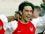 Football - Premier league: Tottenham 2 - Arsenal 2:  Arsenal's Robert Pires (2L), of France, celebrates with Patrick Vieira (L), Ashley Cole (2R) and Thierry Henry (R) after scoring against Tottenham Hotspur during their English premier league soccer match at White Hart Lane, London, April 25, 2004. NO ONLINE/INTERNET USAGE WITHOUT FAPL LICENCE. FOR DETAILS SEE WWW.FAPLWEB.COM REUTERS/Mike Finn-Kelcey