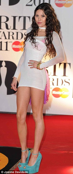 Like a bird: Young singer Eliza Doolittle opted for a short and tight white dress which was decorated with purple and orange feathers at the back