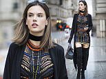 PARIS, FRANCE - MARCH 04:  Alessandra Ambrosio is wearing a dress from Versace Couture, Baja East cardigan, Gianvito Rossi boots, Versace bag, and Linda Farrow sunglasses, Shay jewelry suede choker seen in the streets in Paris on March 4, 2016 in Paris, France.  (Photo by Timur Emek/GC Images)