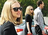 ***MINIMUM OF £250 FOR THIS SET OF PICTURES***\nEXCLUSIVE ALLROUNDERAmanda Seyfried is spotted holding onto actor Thomas Sadoski's pants as they walk back to their trailers on the set of new film 'The Last Word'. Seyfriend recently split from long term boyfriend Justin Long after two years together. The pair were also seen arriving together in Amanda's new car and later on playing with Amanda's dog.\nFeaturing: Amanda Seyfried, Thomas Sadoski\nWhere: Pasadena, California, United States\nWhen: 02 Mar 2016\nCredit: Cousart/JFXimages/WENN.com\n**Not available for publication in Australia or New Zealand**
