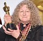 "HOLLYWOOD, CA - FEBRUARY 28:  Costume designer Jenny Beavan, winner of the Best Costume Design award for ""Mad Max: Fury Road,"" poses in the press room during the 88th Annual Academy Awards at Loews Hollywood Hotel on February 28, 2016 in Hollywood, California.  (Photo by Jeff Kravitz/FilmMagic)"