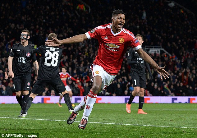 Marcus Rashford celebrates scoring for Manchester United on his debut on Thursday night at Old Trafford