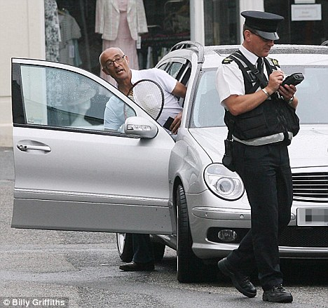 Wham! Andrew Ridgeley getting into his car in Cornwall traffic warden