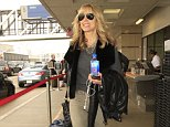 EXCLUSIVE: Donald Trump's ex, Marla Maples is all smiles on the heels of her ex-husband's Super Tuesday victories as he inches closer to the White House.  The former model/television personality was seen flying out of LAX wearing knee-high boots, tight pants, a vest and a grey sweater as she carried her Fiji bottled water and leather jacket.  Pictured: Marla Maples Ref: SPL1239644  020316   EXCLUSIVE Picture by: Sharky / Splash News  Splash News and Pictures Los Angeles: 310-821-2666 New York: 212-619-2666 London: 870-934-2666 photodesk@splashnews.com