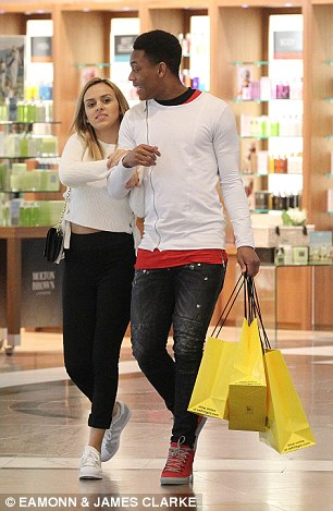 Martial felt a hamstring problem before last week's tie against Midtjylland but couple seem in high spirits (left)