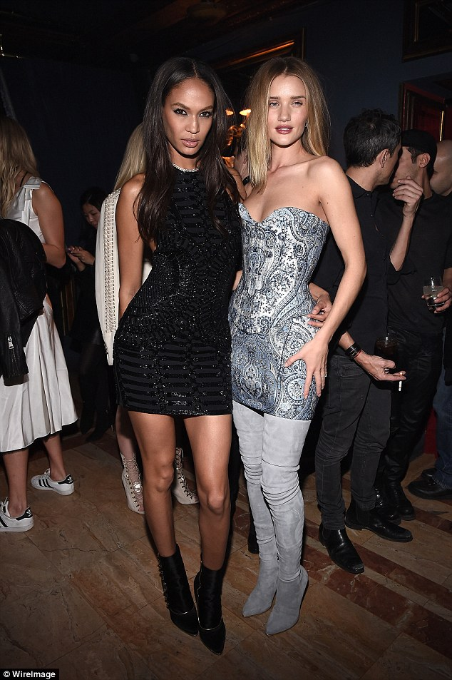 Party look:Rosie Huntington-Whiteley looked gorgeous in her paisley print strapless number and thigh-high boots