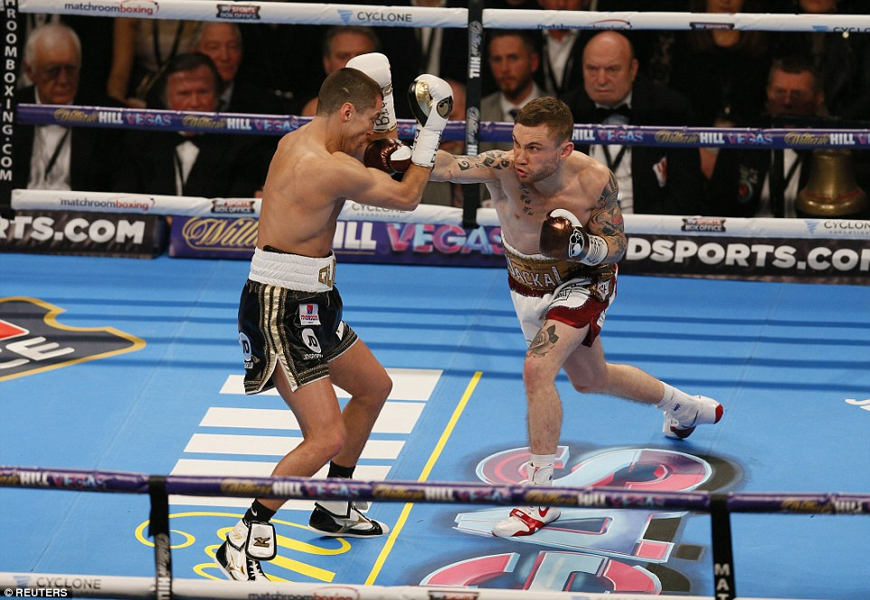 Frampton (right) throws a right punch at Quigg during the opening rounds of their bout at the Manchester Arena