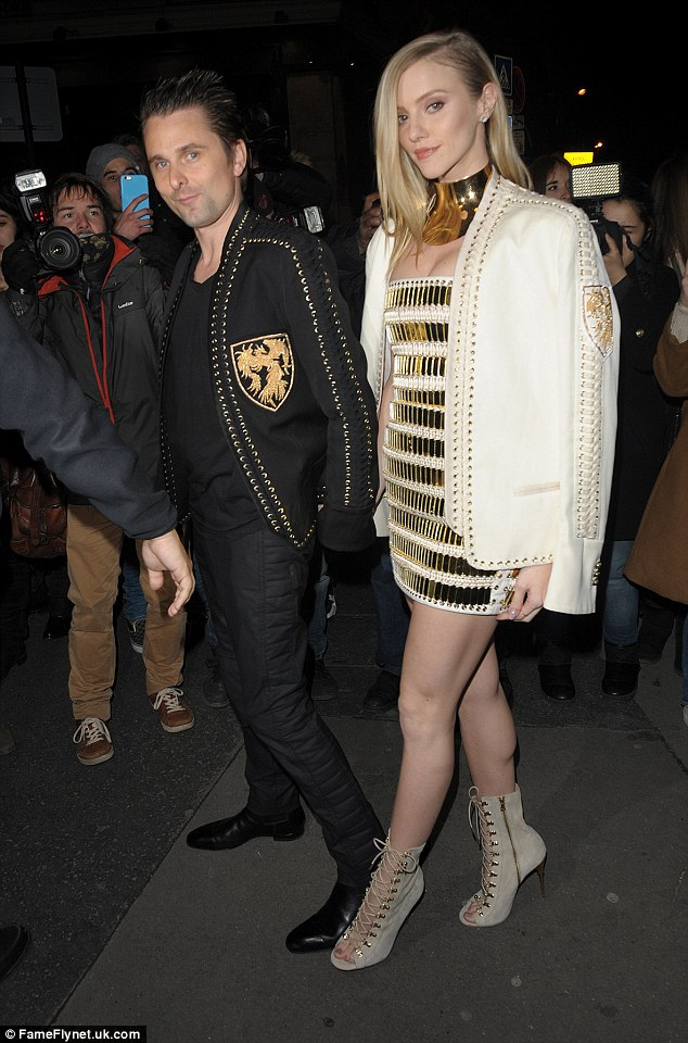 Coordinated couple: The Muse frontman and the model hit the afterparty, in another set of matching outfits