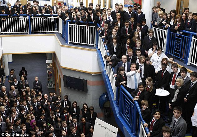 Crunch time: David Cameron, pictured yesterday meeting pupils at Landau Forte College in Derby, must split up the Lib Dem vote by playing on fears of a hung parliament