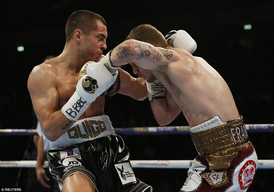 Both boxers try to fight on the inside as the bout steps up in intensity as they trade punches in Manchester