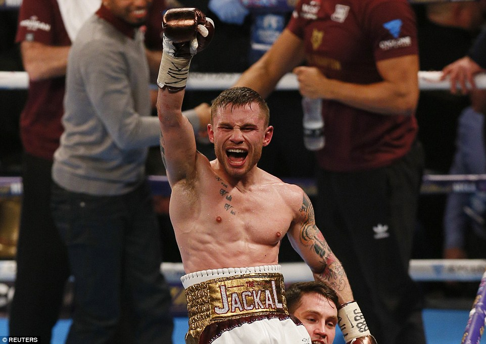 Carl Frampton celebrates after defeating his rival Scott Quigg by a split decision in theirsuper-bantamweight world title bout