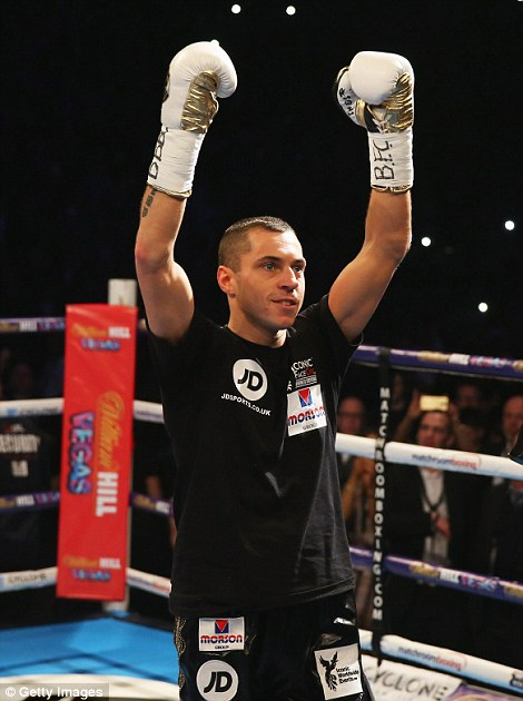 Quigg acknowledges the sold-out Manchester Arena as he enter the ring prior to his bout on Saturday