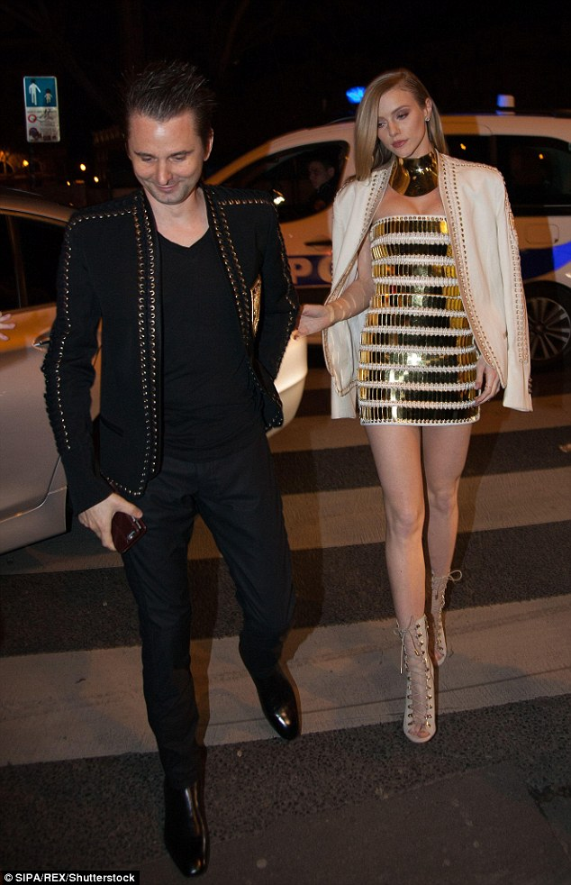 Time to party: Matt looked on cloud nine as he headed inside the party atLaperouse restaurant with gorgeous Elle by his side