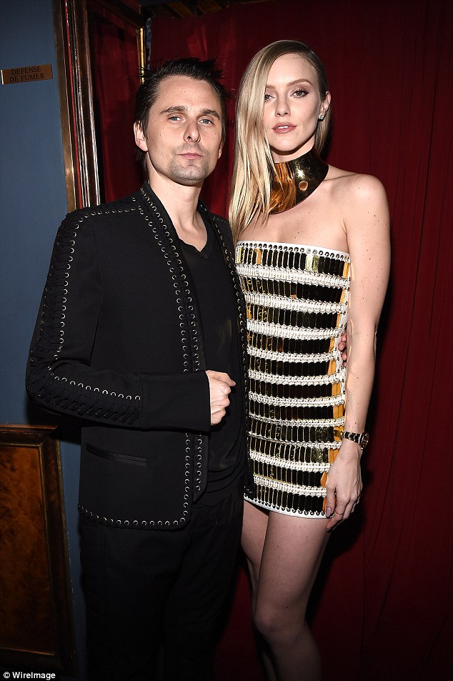 Fashionable pair: Elle showed off her incredible figure in her tiny dress as the couple hit the bash