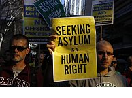 Asylum-seekers 'sew lips' at detention camp