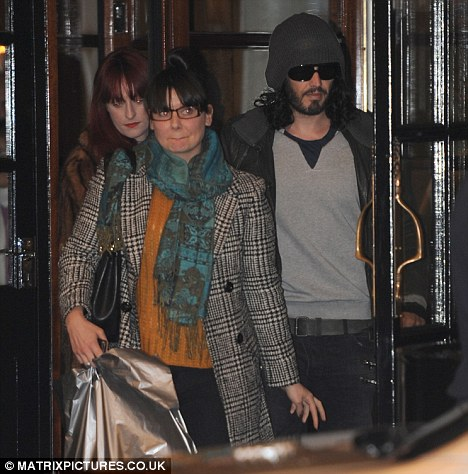 Keeping a low profile: Brand was seen leaving The Savoy Hotel this weekend alongside a woman believed to be singer Florence Welch, although the pair were not together