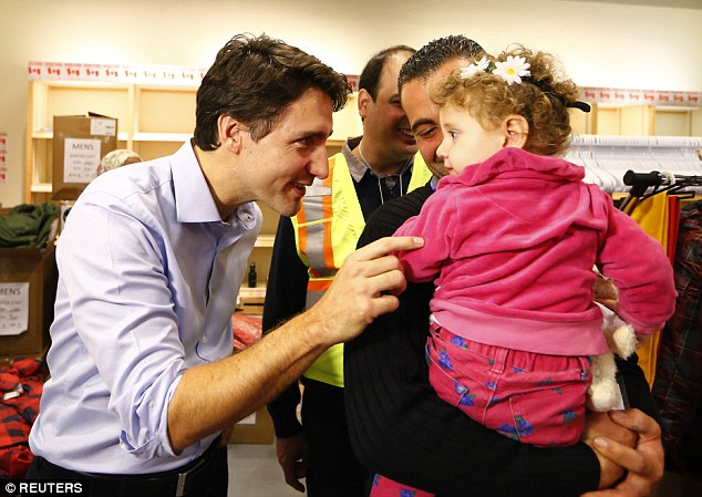 Trudeau himself welcomed the first plane of refugees in December (pictured) as they arrived in Toronto after his pledge to resettle 25,000 Syrian refugees in the country by February