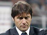 FILE -- In this Fe. 25 file photo, Juventus coach Antonio Conte looks on during the Serie A soccer match between AC Milan and Juventus at the San Siro stadium in Milan.  Coach of Italian champion Juventus, Antonio Conte, was placed under investigation on Monday, May 28, 2012, for alleged wrongdoing while coach of Siena. Italian authorities swept through the Italy national team training site near Florence and made more than a dozen arrests elsewhere Monday as part of a wide-ranging investigation into match-fixing in football. News reports said Lazio captain Stefano Mauri was among those arrested. Police are also investigating Italy and Zenit St Petersburg defender Domenico Criscito a week before the national team leaves for the European Championship in Poland and Ukraine. (AP Photo/Antonio Calanni)