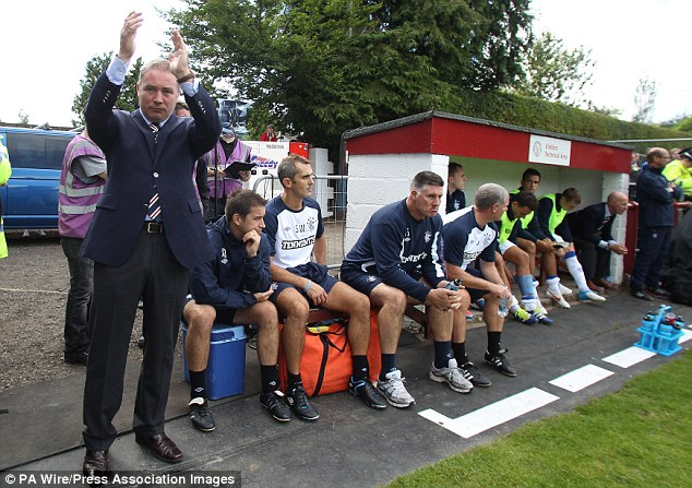 Not quite what you're used to? Rangers boss Ally McCoist salutes the travelling fans