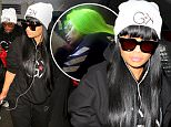 Blac Chyna leaves town without boyfriend Rob Kardashian.  The former stripper took an early morning flight out of LA with her entourage. \nLAX/X17online.com