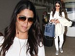 LOS ANGELES, CA, USA - March 04, 2016 : Model Camila Alves seen at LAX Airport on March 04, 2016 in Los Angeles, California, United States.   Pictured: Camila Alves Ref: SPL1241234  040316   Picture by: Splash News  Splash News and Pictures Los Angeles: 310-821-2666 New York: 212-619-2666 London: 870-934-2666 photodesk@splashnews.com