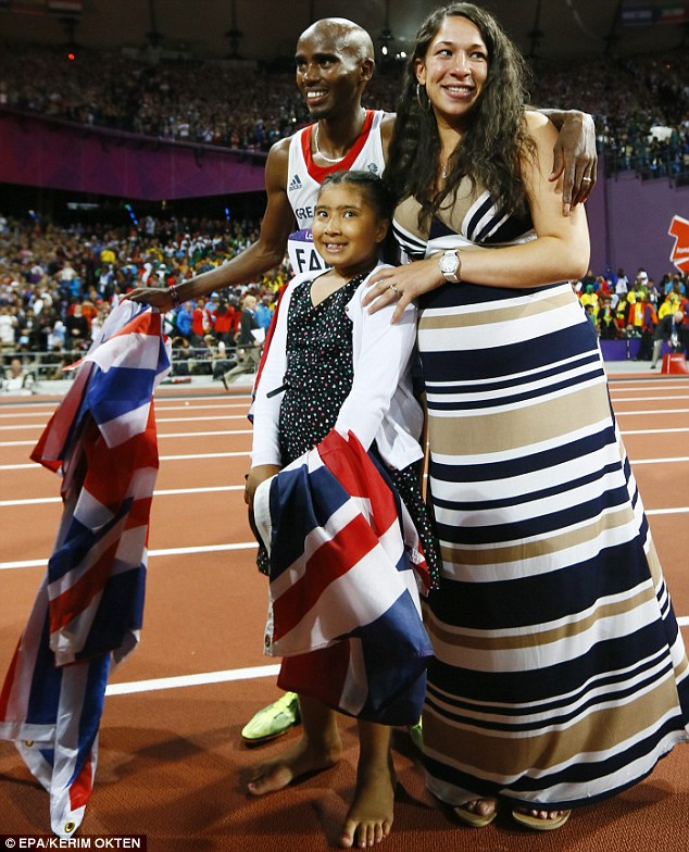Triumph: Wife Tania and stepdaughter Rhianna join Mo after his 10,000 metres win