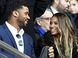 US American football quarterback of the Seattle Seahawks Russell Wilson (L) and his gilfriend US singer Ciara (R) attend the French L1 football match between Paris Saint-Germain (PSG) and Montpellier (MHSC) on March 5, 2016, at the Parc des Princes stadium in Paris. AFP PHOTO / FRANCK FIFEFRANCK FIFE/AFP/Getty Images