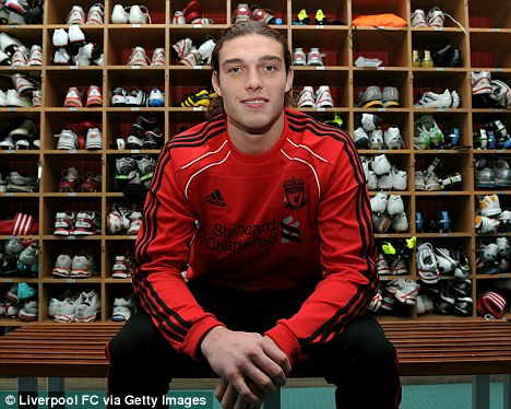 Toon tussle: Andy Carroll at Liverpool's Melwood training ground boot room yesterday