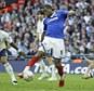 Portsmouth's Fredrique Piquionne scores in the FA Cup semi-final