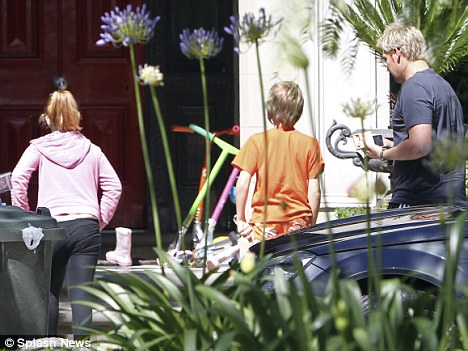 Family first: Warner arrived back at his house in the Melbourne suburb of Brighton to be with his children Summer and Jackson
