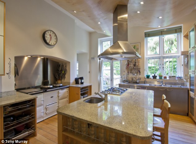 London mansion: The kitchen in the £18million property which originally consisted of three apartments but has been converted into a family home