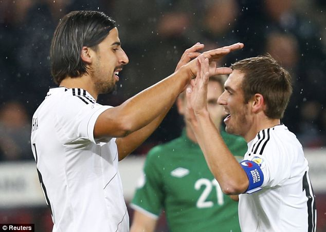 Delight: Khedira (left) celebrates with Philip Lahm