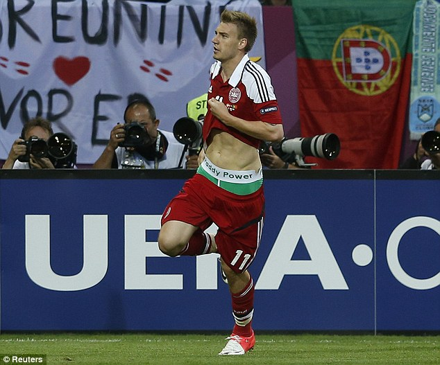 Trouble: Bendtner received an £80,000 fine for displaying pants branded with bookmaker Paddy Power during Euro 2012