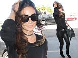 March 7, 2016: Lily Aldridge sports a pair of tight leather pants as she departs LAX Airport, Los Angeles, CA.\nMandatory Credit: INFphoto.com Ref.: inf-00
