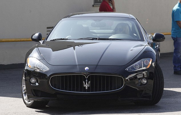 The car: Lindsay, pictured driving her black Maserati in Los Angeles on April 20, 2012, apparently ran a red light while driving the same sports car and struck the nanny who was pushing a baby stroller