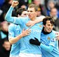 Because I'm worth it: Dzeko (centre) celebrates after drawing City level against Notts County
