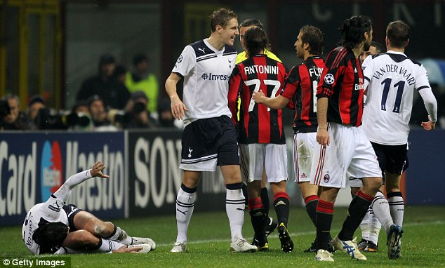 Calm down: Michael Dawson (second left) has words with Mathieu Flamini (fourth right) after the former Arsenal man's two-footed lunge ended Vedran Corluka's (left) evening
