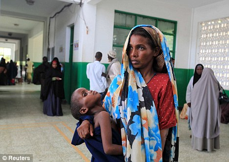 Somalia tied at 182nd as the world's most corrupt country. Here, a displaced Somalian woman stands at Banadir hospital which serves the residents of the world's largest refugee camp