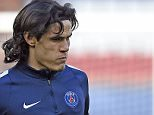 Paris Saint-Germain's Uruguayan forward Edinson Cavani controls the ball during warm up prior to the French L1 football match between Paris Saint-Germain (PSG) and Montpellier (MHSC) on March 5, 2016 at the Parc des Princes stadium in Paris. AFP PHOTO / FRANCK FIFEFRANCK FIFE/AFP/Getty Images