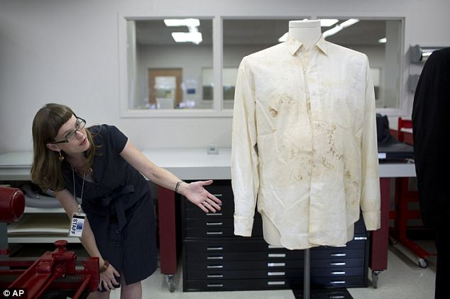 Part of history: Conservator Sarah Norris is seen next to the shirt that was donated by Connally's wife