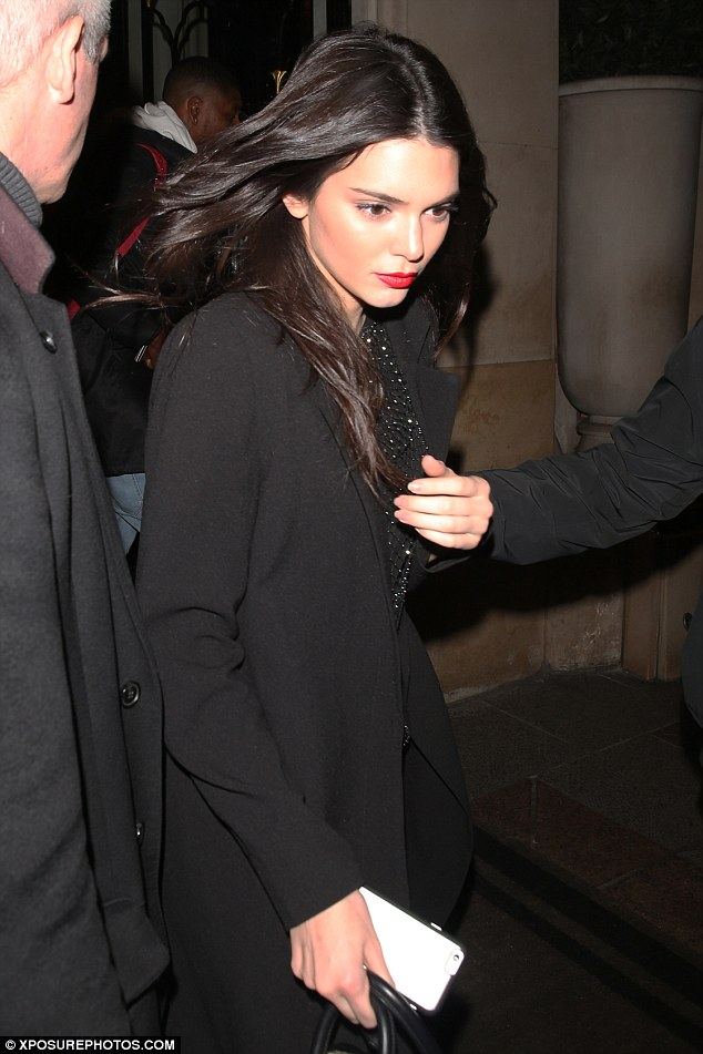 Party time: Kendall Jenner squeezed in some fun during her hectic Paris Fashion Week schedule as she enjoyed a night out with celeb pals atHôtel Plaza Athénée on Monday