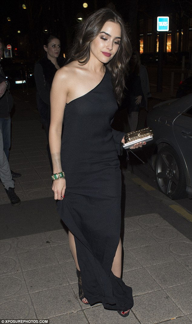 Glam: Olivia looked incredible in a floor-length black dress with sky-high splits